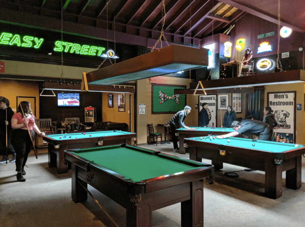 Easy Street Billiards customer playing pool